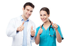 Friendly doctors showing thumbs up Royalty Free Stock Images