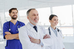 Friendly doctors standing at clinic Royalty Free Stock Photos