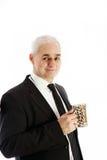 A friendly, elderly gentleman drinking coffee Royalty Free Stock Photo