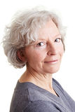 Friendly elderly woman with grey Royalty Free Stock Photos