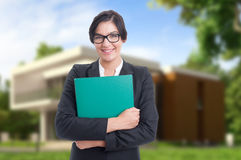 Friendly estate consultant holding big folder Royalty Free Stock Photography