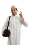 Friendly ethnic man waving Stock Image