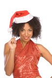 Friendly ethnic Mrs Santa Claus wearing hat Royalty Free Stock Photography
