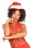 Friendly ethnic Mrs Santa Claus wearing hat Royalty Free Stock Image