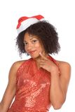Friendly ethnic Mrs Santa Claus wearing hat Stock Images