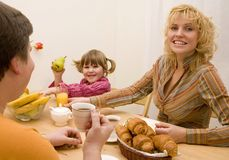 Friendly family. Have a breakfast at the table Stock Photos