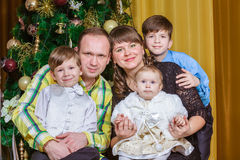 Friendly family on Christmas evening Stock Images