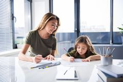 Friendly family drawing pictures together royalty free stock image