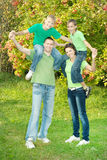Friendly family in green shirts Stock Photography