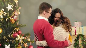 Friendly family hugging, congratulating each other on holidays, idyll at home stock images
