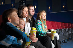 Friendly family with interest watching a movie Royalty Free Stock Photos
