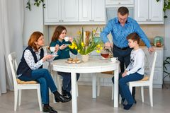 Friendly family. Morning tea. Father pours tea stock photography