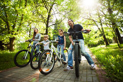 Friendly family is on a picnic. Biking. Fun friendly family is on a picnic. Biking Royalty Free Stock Photography