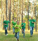 Friendly family running Stock Images