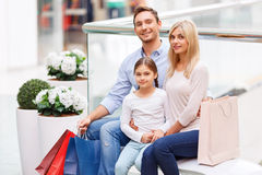Friendly family sitting on the bench Stock Photography