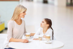 Friendly family sitting in the cafe Stock Photo