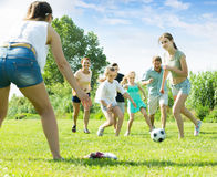 Friendly family of six people happily playing in football togeth Stock Photo