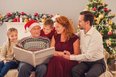 Friendly family viewing album on holiday Stock Image