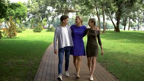 Free Friendly Family Walking Along Park, Mom Spending Time With Teenage Children Stock Image - 139865111