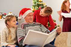 Friendly family watching photos on Christmas stock photos