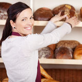 Friendly female bakery employee Royalty Free Stock Images
