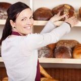 Friendly female bakery employee Royalty Free Stock Images