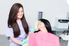 Friendly female dentist showing care for young patient Royalty Free Stock Image