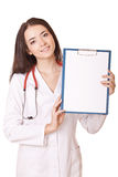 Friendly female doctor with blank clipboard Royalty Free Stock Photography