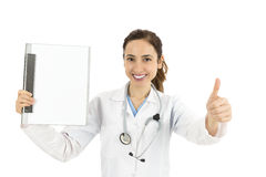 Friendly female doctor with a clipboard giving thumbs up Royalty Free Stock Photos