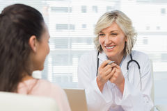 Friendly female doctor in conversation with patient Royalty Free Stock Image