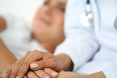 Friendly female doctor hands Stock Photography
