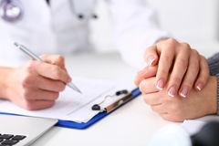 Friendly female doctor hold patient hand Royalty Free Stock Photo