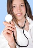Friendly female doctor with stethoscope Royalty Free Stock Photo
