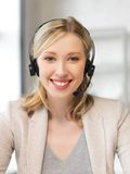 Friendly female helpline operator Royalty Free Stock Photography