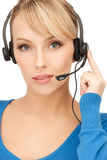Friendly female helpline operator Royalty Free Stock Image