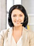 Friendly female helpline operator Royalty Free Stock Photography