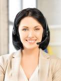 Friendly female helpline operator Stock Photography