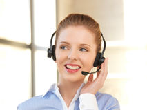 Friendly female helpline operator Stock Photography
