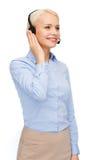 Friendly female helpline operator Stock Image