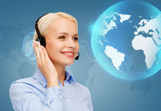 Friendly female helpline operator. Business, technology and call center concept - friendly female helpline operator with headphones Stock Images
