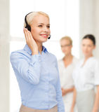 Friendly female helpline operator Royalty Free Stock Image