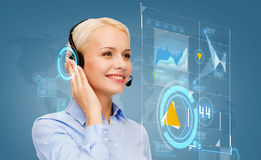 Friendly female helpline operator. Business, technology and call center concept - friendly female helpline operator with headphones Stock Image