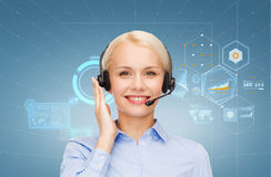 Friendly female helpline operator. Business, technology and call center concept - friendly female helpline operator with headphones Stock Photo