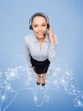 Friendly female helpline operator with headphones Royalty Free Stock Image