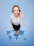Friendly female helpline operator with headphones Royalty Free Stock Images