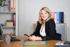 Friendly female helpline operator with headphones Royalty Free Stock Image