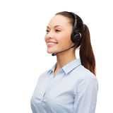 Friendly female helpline operator with headphones Stock Image