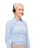 Friendly female helpline operator with headphones Royalty Free Stock Photography