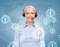 Friendly female helpline operator with headphones Royalty Free Stock Photo