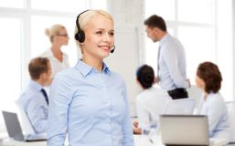 Friendly female helpline operator with headphones Stock Photos